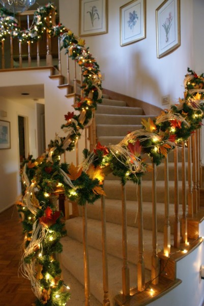 stair bannister decorated for thanksgiving and christmas