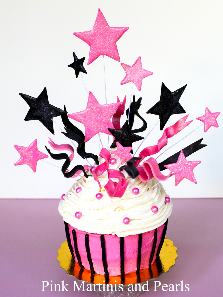 jumbo birthday cupcake with stars and fondant ribbons