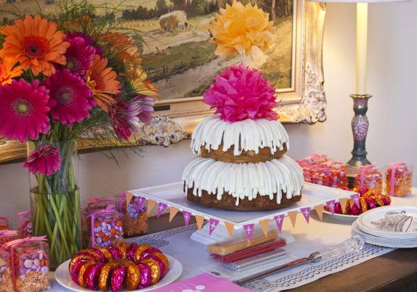 Pink and Orange Birthday Cake and Favors Table