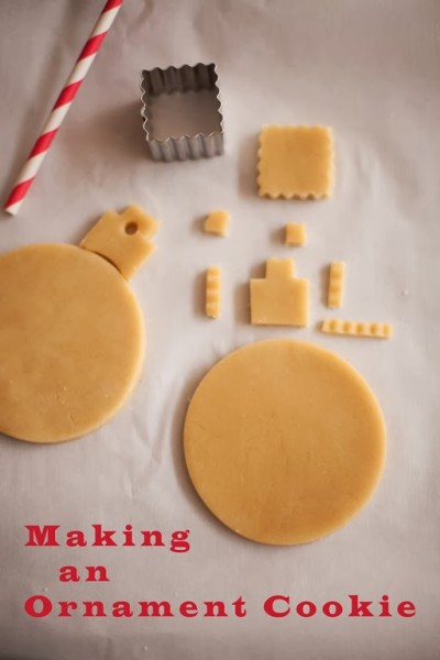 decorated pink christmas ornament cookies with fondnt snowflake