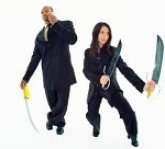 Businesswoman with swords defending businessman on mobile phone